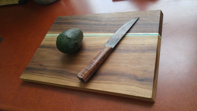 Cutting board with skateboard accent