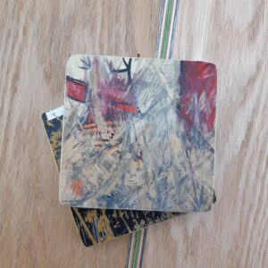 A set of two coasters handcrafted from recycled skateboard decks